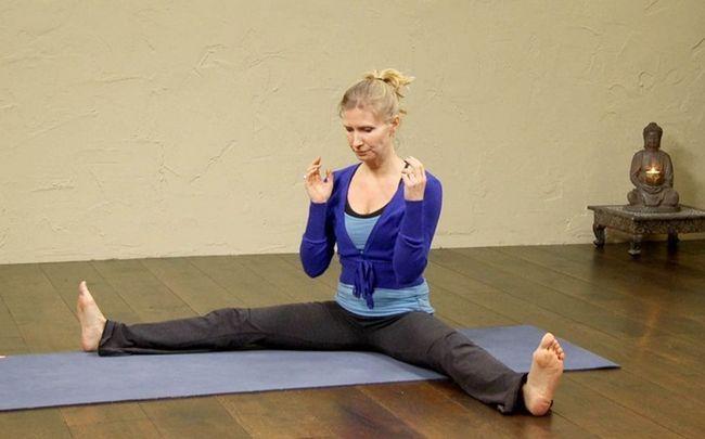 Yoga-Posen für PCOS - Mühle Buttern stellen (oder chakki chalanasana)